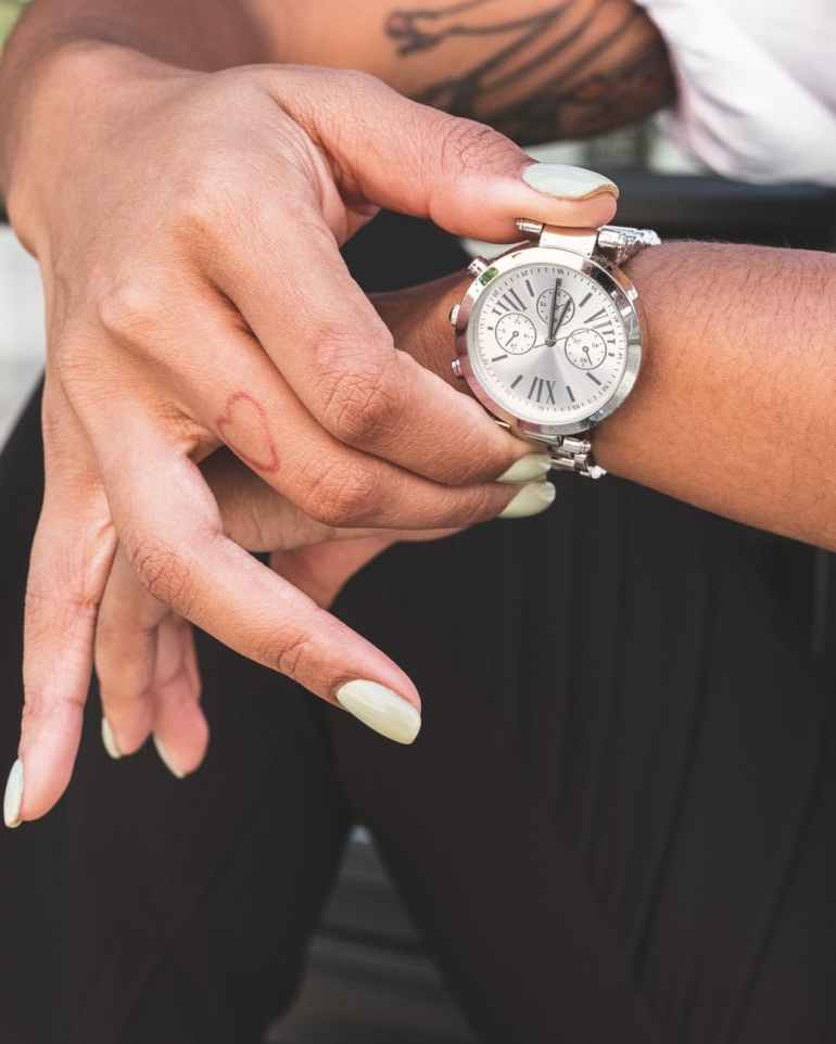 a chronograph watch on a person wrist